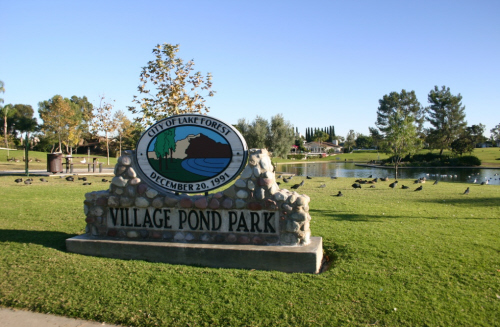 A stone sign at the entrance of Village Pond Park